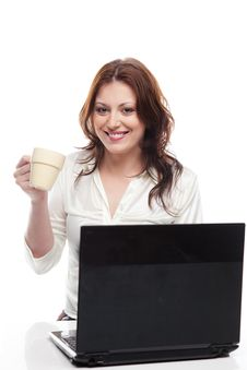 Girl Sitting At Table With Laptop And Cup Stock Photos