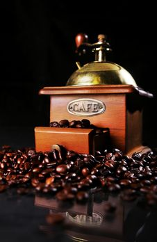 Free Coffee Mill On The Table With Coffee Beans Around Stock Image - 17886501