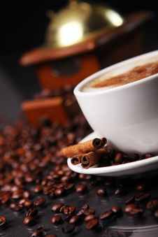 Free Coffee Cup On The Table With Coffee Beans Around Stock Image - 17886531