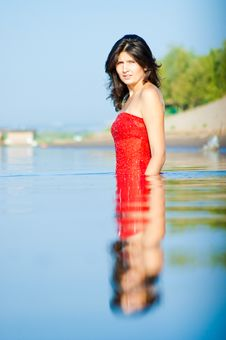 Woman In Red Dress On Coast Royalty Free Stock Photo