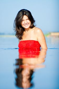 Woman In Red Dress On Coast Royalty Free Stock Photography