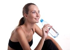 Free Woman In Fitness Pose Holding Water Bottle Royalty Free Stock Images - 17889539
