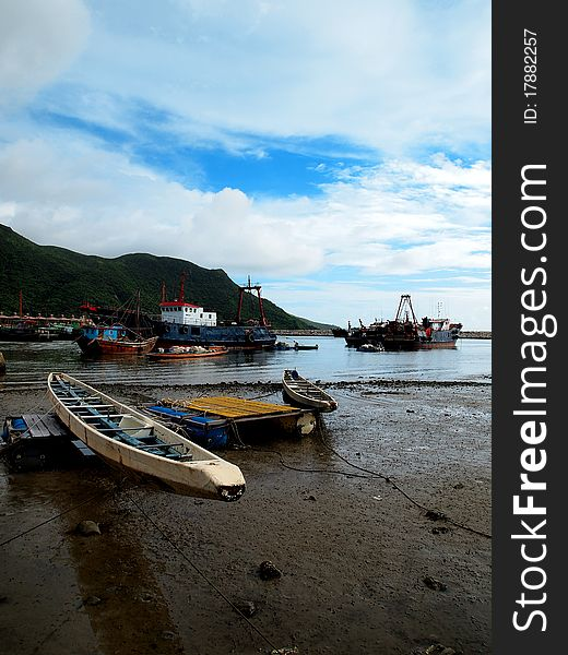 Rowing Boat and Fishing Ships
