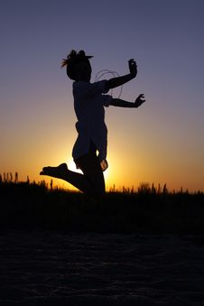 Free Young Woman Jumping At The Sunset Royalty Free Stock Photo - 17890605