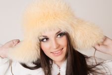 Happy Brunette Girl With Furry Hat Royalty Free Stock Image