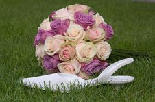 Bridal Bouquet And Bridal Shoe In Grass