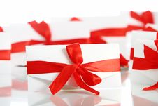 Free Gift Envelope With Awesome Red Bow Stock Photography - 17892862