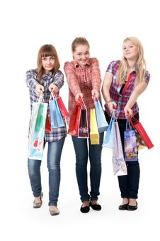Three Girls With Colorful Shopping Bags Stock Photos