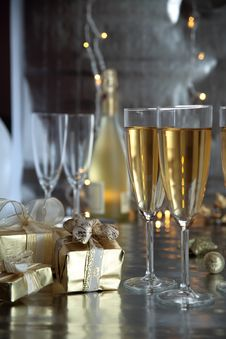 Champagne In Glasses And Gifts Stock Photo