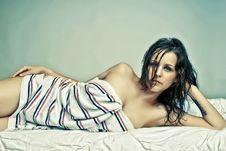 Attractive Lying Brunette Girl In Towel Stock Image