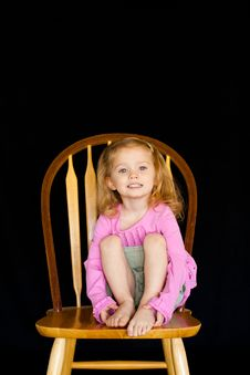 Free Cute Girl On A Chair Royalty Free Stock Image - 17897916