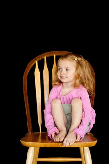 Free Cute Girl On A Chair Stock Photo - 17897920