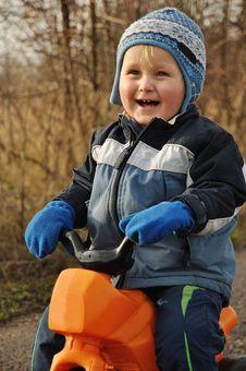Smiling Child Sitting On Motorbike Royalty Free Stock Image