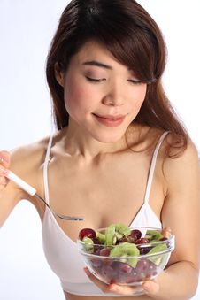 Free Beautiful Japanese Woman Eating Kiwi And Grapes Stock Photos - 17898253