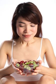 Free Beautiful Japanese Woman Holding Bowl Of Fruit Royalty Free Stock Photography - 17898287