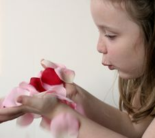 Free Girl Blowing Rose Petals 3 Stock Images - 1794334