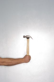 Man Holding A Hammer Royalty Free Stock Images