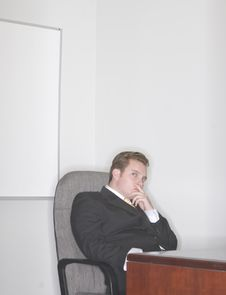 Businessman Sitting In His Chair Royalty Free Stock Photo