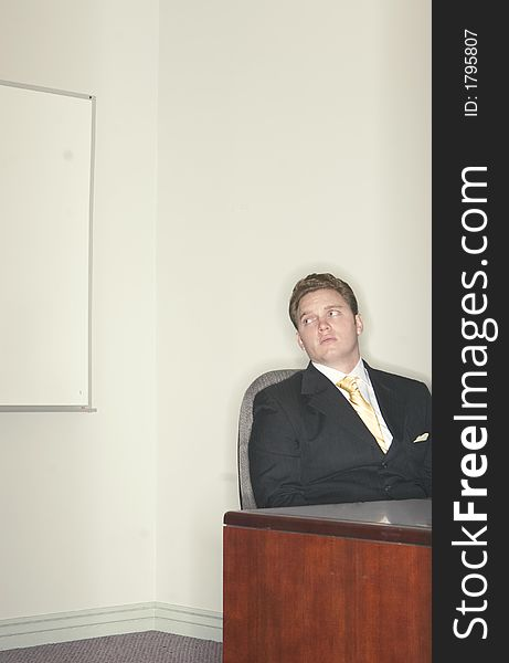 Businessman looking over