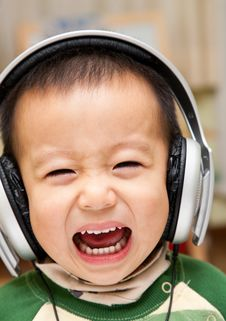 Child And Headphone Stock Image
