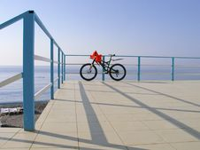 Free Alone Bicycle At The Seafront Fence In Sunny Day Royalty Free Stock Photography - 17902657