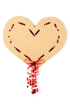 Cardboard Heart With A Red Ribbon Royalty Free Stock Image