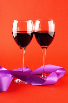Free Two Glasses Of Wine On A Red Background. Royalty Free Stock Photography - 17905737