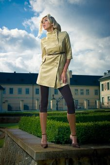 Attractive Fashion Blond Girl In Castle Park Royalty Free Stock Photography