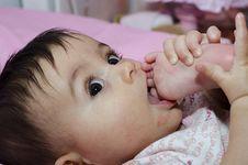 Free Baby Girl Sucking Her Toe Stock Photo - 17909690