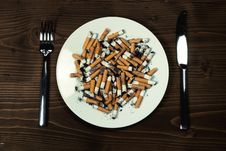 Free Plate With Cigarettes Stubs Royalty Free Stock Image - 17910706