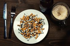 Free Plate With Cigarettes Stubs Royalty Free Stock Photos - 17910708