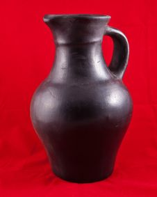 Free Black Jug On Red Royalty Free Stock Photo - 17912475