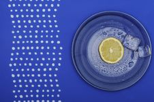 Free Fresh Lemon On The Blue Plate Royalty Free Stock Images - 17913449