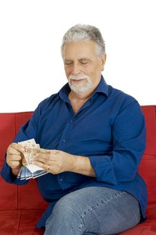 Free Elderly Man On The Couch With Money In Hand Stock Images - 17914974