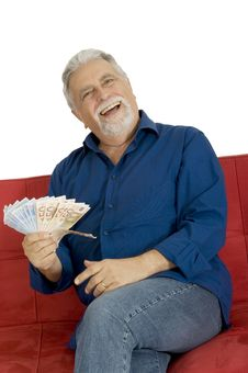 Free Elderly Man On The Couch With Money In Hand Stock Photos - 17915003