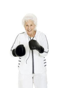 Elderly Woman With Boxing Gloves Stock Images