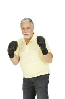 Elderly Man With Boxing Gloves Royalty Free Stock Photo
