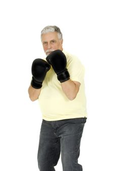 Elderly Man With Boxing Gloves Stock Photos