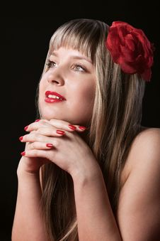 Happy Blond With Red Flower In Hair Stock Photography