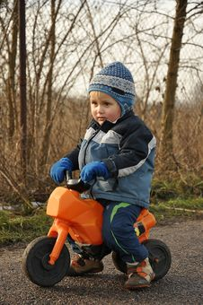 Free Little Boy Riding Motorbike Royalty Free Stock Images - 17915449