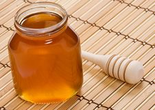 Free Pot Of Honey And Wooden Stick Stock Image - 17919601