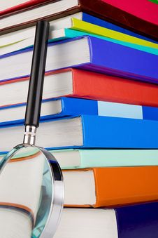 New Books And Magnifier Royalty Free Stock Photos