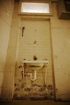 Ancient Basin On Grunge Wall Stock Photo