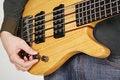 Free Man Tuning Bass Guitar Royalty Free Stock Images - 17927439