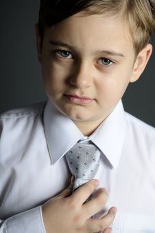 Free Schoolboy Arranging Tie Stock Photos - 17920213