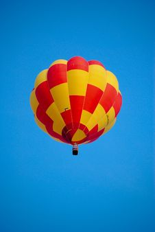 Red & Yellow Balloon On The Blue Sky. Royalty Free Stock Photo