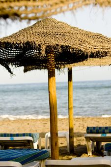 Free Straw Umbrella And Chairs Stock Photos - 17927073
