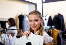 Free Young Woman In A Shop Buying Clothes Royalty Free Stock Photography - 17927587