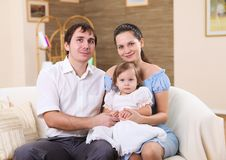 Young Family At Home With A Daughter Royalty Free Stock Images