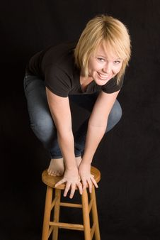 Free Young Woman On Stool Royalty Free Stock Photo - 17928905